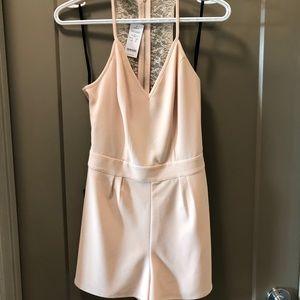 Light/pale pink lace back Romper